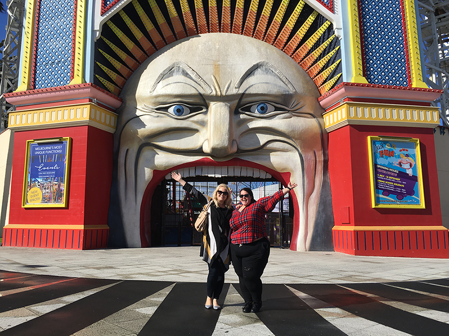Style bloggers Meagan Kerr and Curvy Sam at the entrance to Luna Park in Melbourne, Australia