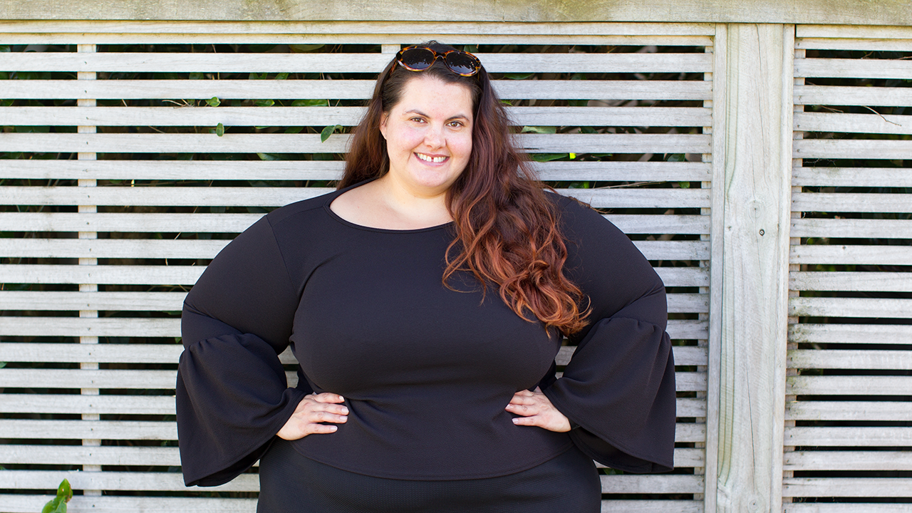 Meagan Kerr wears Boohoo Plus Tara Crepe Frill Sleeve Top in size 26