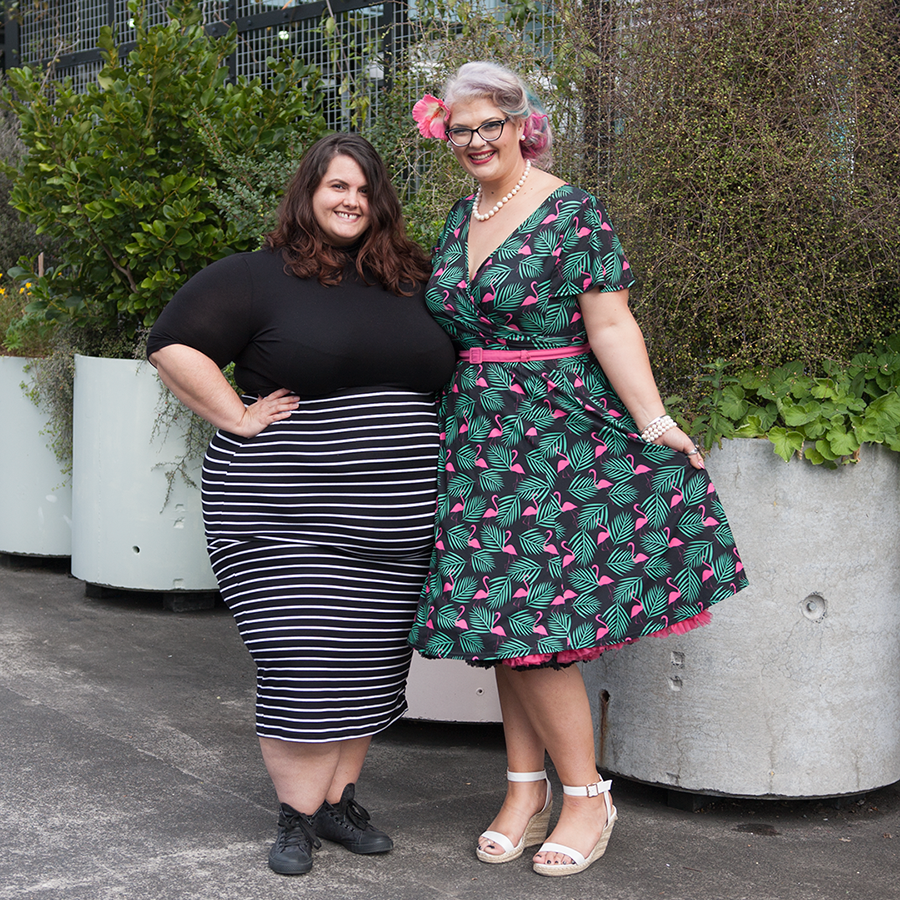 Meagan Kerr wears ASOS CURVE Turtleneck and Harlow Sweetest Taboo Skirt; Hannah Gough from Survivor New Zealand wears Lady Voluptuous Lyra Art Deco Flamingo Dress / Photo: Doug Peters, Ambient Light