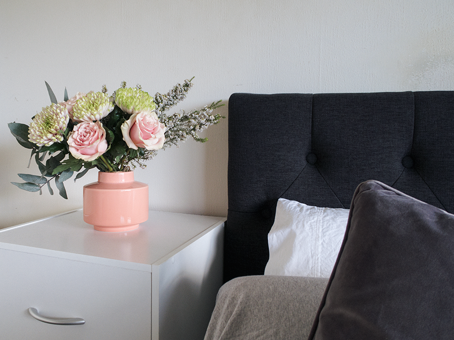 Meagan Kerr's room tour and bedroom makeover on a budget. Headboard from Elite Products, bed from Sleepyhead, bedding from The Warehouse and EziBuy, bedside table and vase from The Warehouse, flowers from Flower Station