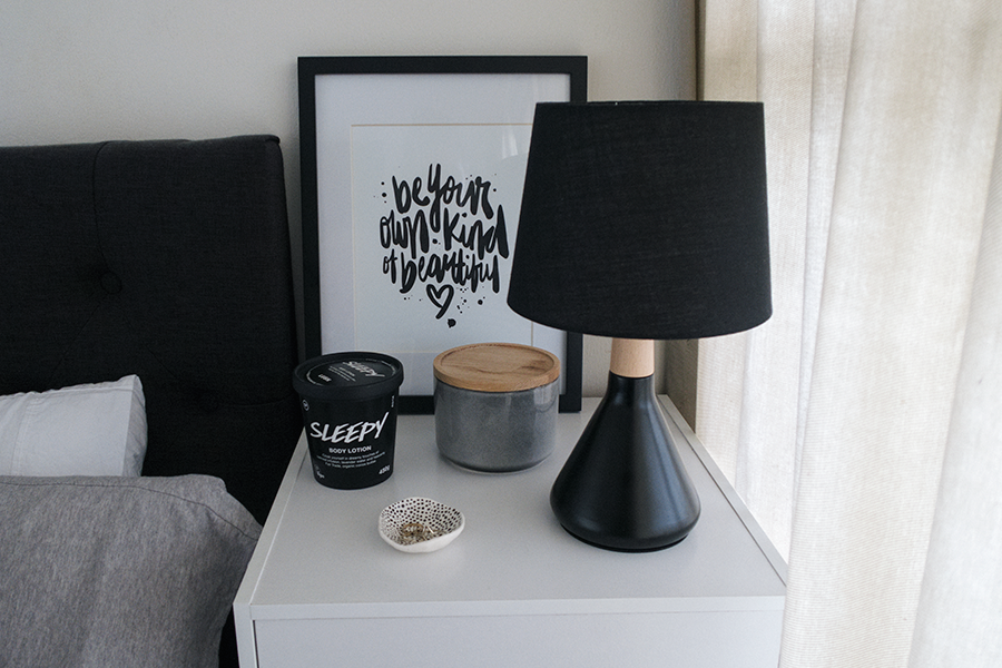 Meagan Kerr's room tour and bedroom makeover on a budget. Headboard from Elite Products, bed from Sleepyhead, bedding from The Warehouse and EziBuy, bedside table and lamp from The Warehouse, trinket dish from Makerie Ceramics, grey canister from Kmart, Sleepy body lotion from Lush, Be Your Own Kind Of Beautiful print by Maiko Nagao