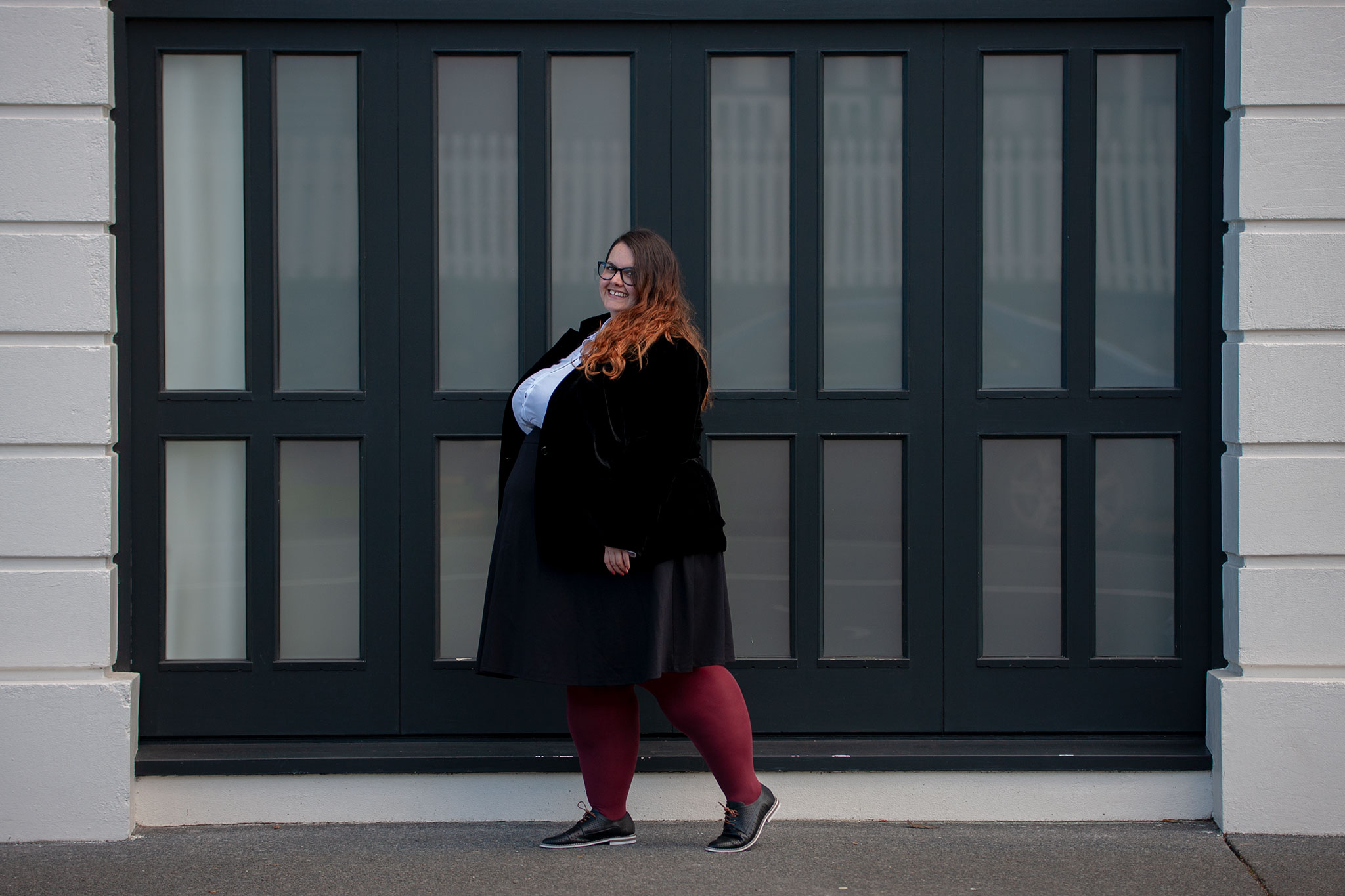 New Zealand plus size blogger Meagan Kerr wears 17 Sundays Basic Longline White Button Up Shirt, Lane Bryant Ponte Circle Skirt, Sara Velvet Blazer from Ezibuy, Pamela Mann 90 Denier Maxi Opaque Plus Size Tights from The Tight Spot, Emerge Anaheim Cut-out Lace Up Court Flat from Ezibuy, Alexa Glasses from Specsavers. Photo by Doug Peters / Ambient Light